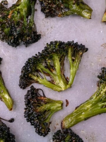 oven roasted broccoli close up on a sheet tray