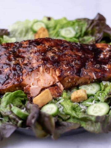 Balsamic glazed salmon on a bed of lettuce