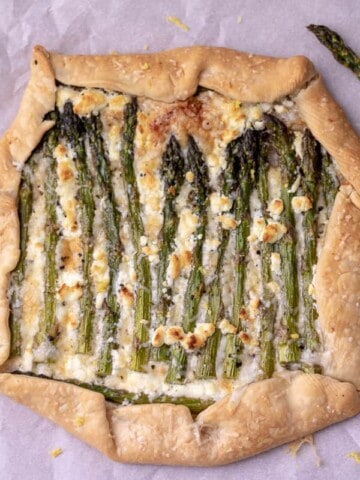 overhead of the whole galette with asparagus in the corner.