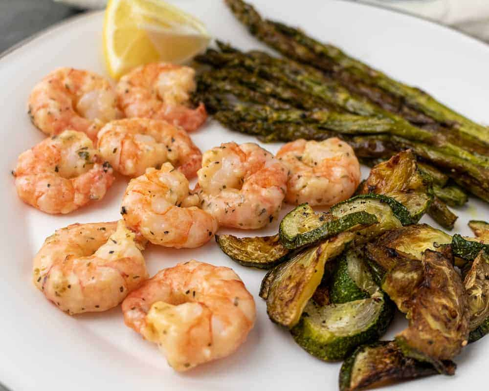 Garlic and parm shrimp with roasted asparagus and zucchini.