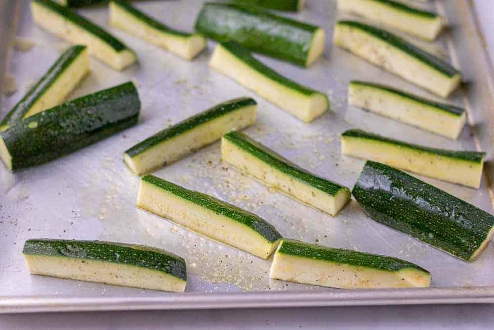 Raw zucchini on a sheet tray