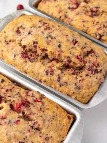 3 mini loaves of cranberry orange bread in their loaf pans