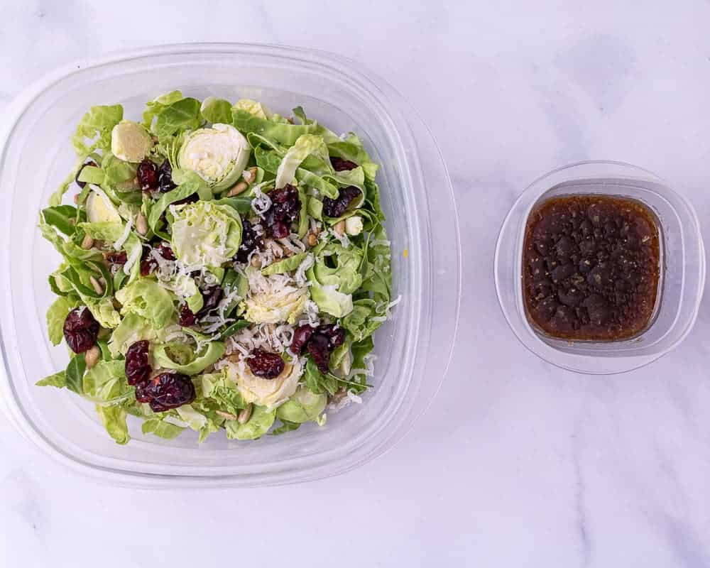One close up of the shredded brussels sprout salad and dressing