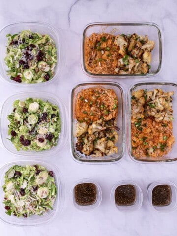 3 containers of shredded buffalo chicken and cauliflower with three meal prep salads.