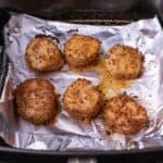 Air fryer cajun scallops in the air fryer basket.