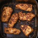 Cooked air fryer parmesan crusted chicken in the air fryer