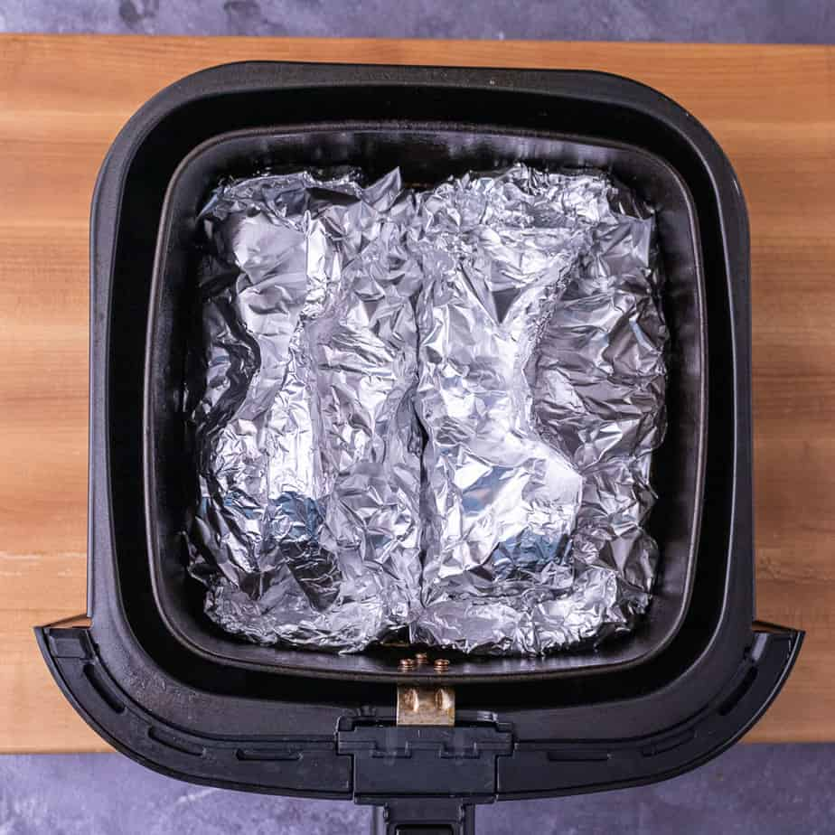 2 foil packets in the air fryer basket.