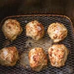 Cooked meatball in the air fryer basket