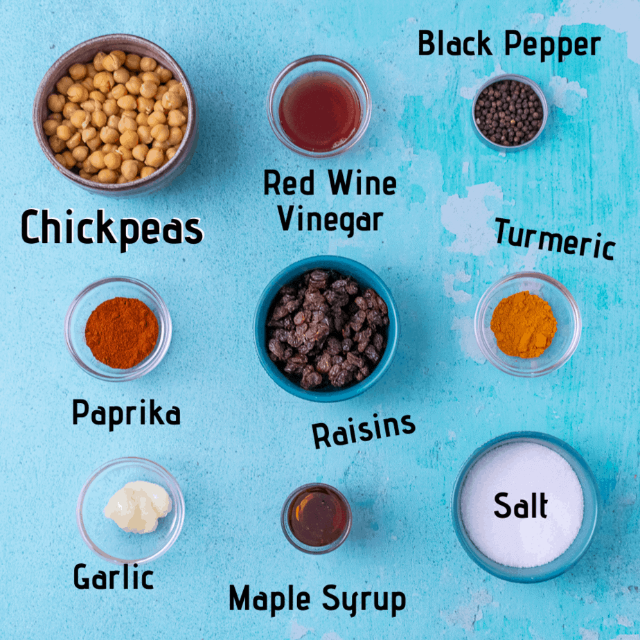Half of the ingredients laid out for the chickpea salad on a blue background.