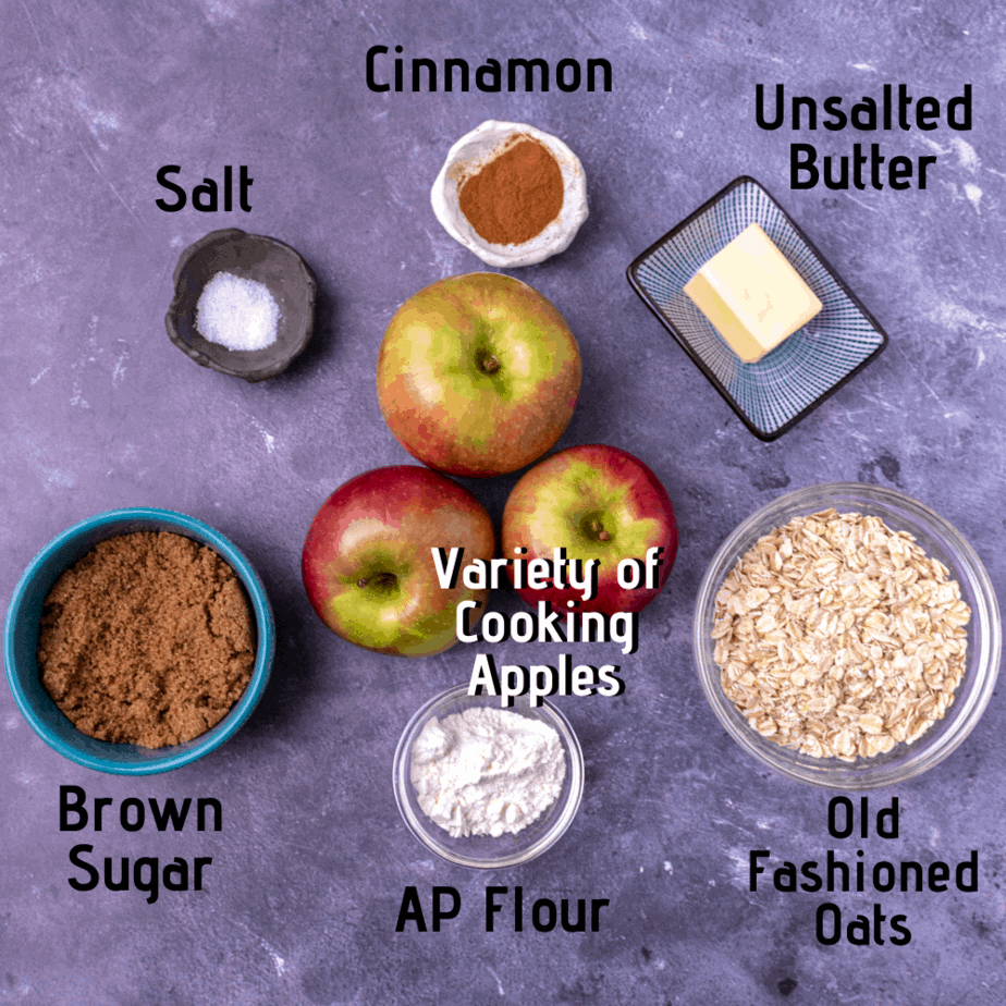 Raw ingredients laid out and labeled: Salt, ground cinnamon, unsalted butter, brown sugar, AP four, old fashioned oats and a variety of cooking apples.